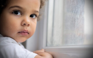 Child by a window
