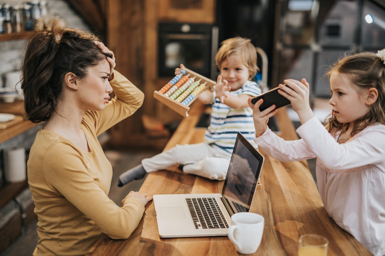 mother with children at a table working